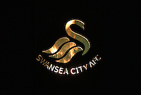 Pictured: Flames behind a Swansea City FC logo 01 April 2015<br />