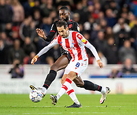 1st October 2021;  Bet365 Stadium, Stoke, Staffordshire, England; EFL Championship football, Stoke City versus West Bromwich Albion; Mario Vrancic of Stoke City under pressure from  Semi Ajayi of West Bromwich Albion
