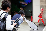 """Photographers line up to take pictures of a cosplayer during the Niconico Douga fan event at Makuhari Messe International Exhibition Hall on April 25, 2015, Chiba, Japan. The event includes special attractions such as J-pop concerts, Sumo and Pro Wrestling matches, cosplay and manga and various robot performances and is broadcast live on via the video-sharing site. Niconico Douga (in English """"Smiley, Smiley Video"""") is one of Japan's biggest video community sites where users can upload, view, share videos and write comments directly in real time, creating a sense of a shared watching. According to the organizers more than 200,000 viewers for two days will see the event by internet. The popular event is held in all 11 halls of the huge Makuhari Messe exhibition center from April 25 to 26. (Photo by Rodrigo Reyes Marin/AFLO)"""