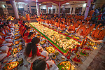 """Pictured: Tens of thousands of Hindu worshipers gather on dozens of floors to celebrate Rakher Upobash, last night, (Tuesday 10th), a fasting festival at Lokenath Brahmachari Temple in Dhaka , Bangladesh.<br /> <br /> The festival is held on every Saturday and Tuesday during the last 15 days in the month of """"Kartik"""" in the Bengali calendar.<br /> <br /> Lighting small lamps, also known as Prodips, and special incense, Hindu worshipers fast and pray in earnest to the gods for favours during this  traditional ritual called Kartik Brati or Rakher Upobash. <br /> <br /> Lokenath Brahmachari, mostly known as Baba Lokenath, was an 18th Century Hindu saint and philosopher in Bengal.<br /> <br /> Please byline: Badal Chandra Sarker/Solent News<br /> <br /> © Badal Chandra Sarker/Solent News & Photo Agency<br /> UK +44 (0) 2380 458800"""