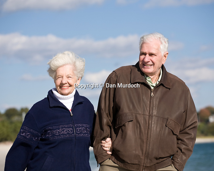 Seniors on a beach walk