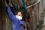 A Palestinian girl from Gaza hanging the laundry while wearing a face mask due to Corona 19 on march 30, 2020. Photo by Osama Baba