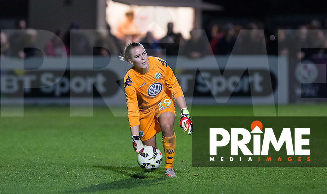 Goalkeeper Merle Frohms of VfL Wolfsburg Women rolls the ball out during the UEFA Women's Champions League Round of 16 match between Chelsea Ladies and VfL Wolfsburg at Wheatsheaf Park, Staines, England on 11 November 2015. Photo by Andy Rowland/PRiME Media Images