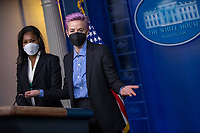 American professional soccer players Megan Rapinoe (R) and Margaret Purce (L) have their picture taken at the briefing room podium prior to the event to mark Equal Pay Day in the State Dining Room of the White House in Washington, DC, USA, 24 March 2021. Equal Pay Day marks the extra time it takes an average woman in the United States to earn the same pay that their male counterparts made the previous calendar year.<br /> CAP/MPI/RS<br /> ©RS/MPI/Capital Pictures