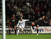 Pictured: Jordi Gomez of Swansea (C) is kicked in the face by Marciano Van Homoet of Barnsley (R)<br /> Re: Coca Cola Championship, Swansea City FC v Barnsley at the Liberty Stadium. Swansea, south Wales, Tuesday 09 December 2008.<br /> Picture by D Legakis Photography / Athena Picture Agency, Swansea 07815441513