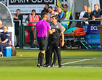 9th October 2021;  VBS Community Stadium, Sutton, London; EFL League 2 football, Sutton United versus Port Vale; Port Vale's manager Darrell Clarke arguing with the referee about Sutton United's second goal before being given a yellow card.