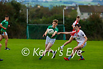 Shane Browne St Kierans gets his pass away from Cillian O'Neill West Kerry during their minor County Championship clash in Castleisland on Saturday
