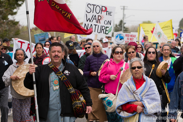 First Nations from across Turtle Island lead the Red Head March. On May 30, 2015, over 500 Canadian citizens and First Nations marched in Red Head, Saint John, at the End of the Line for the proposed Energy East pipeline. The people were protesting the proposed mega pipeline and the tank terminal that would destroy the Red Head community and endanger the Bay of Fundy. If approved, TransCanada's Energy East pipeline would travel 4600km from Alberta to Saint John, New Brunswick, shipping 1.1 million barrels of crude oil and bitumen for export through the Bay of Fundy, a critical habit for Right whales and home to thousands of jobs in Tourism and Fishing.