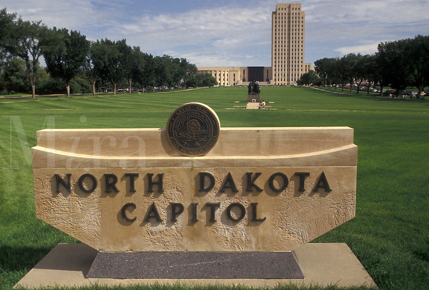 """AJ3534, State Capitol, Bismarck, State House, North Dakota, North Dakota State Capitol sign in the foreground with the State Capitol Building """"""""skyscraper of the prairie"""""""" in the distance in the capital city of Bismarck in the state of North Dakota."""