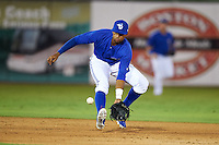 Dunedin Blue Jays shortstop Richard Urena (7) fields a ground ball during the second game of a doubleheader against the Palm Beach Cardinals on July 31, 2015 at Florida Auto Exchange Stadium in Dunedin, Florida.  Dunedin defeated Palm Beach 4-0.  (Mike Janes/Four Seam Images)