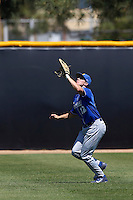 Cameron Newell #12 of the UC Santa Barbara Gauchos waits under a fly ball during a game against the Cal State Northridge Matadors at Matador Field on May 11, 2013 in Northridge, California. UC Santa Barbara defeated Cal State Northridge, 6-2. (Larry Goren/Four Seam Images)