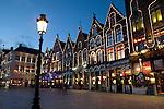 Belgium, West-Flanders, Bruges: Restaurants in the Market Square at dusk