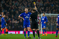 Aron Gunnarsson of Cardiff City receives a yellow card during the Sky Bet Championship match between Aston Villa and Cardiff City at Villa Park, Birmingham, England on 10 April 2018. Photo by Mark  Hawkins / PRiME Media Images.