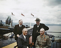 The Quebec Conference, Canada, August 1943 Group photograph on the terrace of the Citadel in Quebec, on the occasion of the First Quebec Conference, with the Chateau Frontenac in the background. Front row: President Roosevelt of the United States and the Earl of Athlone, Governor General of Canada; back row: Mr Mackenzie-King, Prime Minister of Canada and the Prime Minister, the Right Hon Winston Churchill, MP.