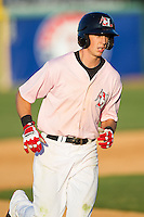 Ryan Cordell (13) of the Hickory Crawdads rounds the bases after hitting a home run against the Augusta GreenJackets at L.P. Frans Stadium on May 11, 2014 in Hickory, North Carolina.  The GreenJackets defeated the Crawdads 9-4.  (Brian Westerholt/Four Seam Images)