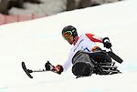 Josh Dueck, Sochi 2014 - Para Alpine Skiing // Para-ski alpin.<br /> Josh Dueck competes in the men's Super G, sitting event // Josh Dueck participe au Super G masculin, épreuve assise. 09/03/2014.