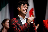 Stage IV finalist Valerio Lisci from Italy applauds during the awards ceremony of the 11th USA International Harp Competition at Indiana University in Bloomington, Indiana on Saturday, July 13, 2019. (Photo by James Brosher)