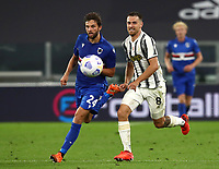 Calcio, Serie A: Juventus - Sampdoria, Turin, Allianz Stadium, September 20, 2020.<br /> Juventus' Aaron Ramsey (r) in action with Sampdoria's Bartosz Bereszynski (l) during the Italian Serie A football match between Juventus and Sampdoria at the Allianz stadium in Turin, September 20,, 2020.<br /> UPDATE IMAGES PRESS/Isabella Bonotto