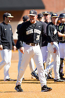 Wake Forest Demon Deacons head coach Tom Walter (32) voices his displeasure with a call during the game against the Youngstown State Penguins at Wake Forest Baseball Park on February 24, 2013 in Winston-Salem, North Carolina.  The Demon Deacons defeated the Penguins 6-5.  (Brian Westerholt/Four Seam Images)