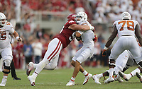 Arkansas defensive lineman John Ridgeway (99) stops Texas quarterback Hudson Card (1), Saturday, September 11, 2021 during the second quarter of a football game at Reynolds Razorback Stadium in Fayetteville. Check out nwaonline.com/210912Daily/ for today's photo gallery. <br /> (NWA Democrat-Gazette/Charlie Kaijo)