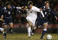 Patrick Mullins #15 of the University of Maryland  pushes past Andres Casais #6 and Drew Cost #8 of Penn State during an NCAA 3rd. round match at Ludwig Field, University of Maryland, College Park, Maryland on November 28 2010.Maryland won 1-0.