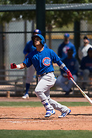 Chicago Cubs second baseman Orian Nunez (18) follows through on his swing during an Extended Spring Training game against the Colorado Rockies at Sloan Park on April 17, 2018 in Mesa, Arizona. (Zachary Lucy/Four Seam Images)