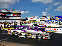 Aug 15, 2014; Brainerd, MN, USA; NHRA pro stock driver Vincent Nobile (near lane) races alongside V. Gaines during qualifying for the Lucas Oil Nationals at Brainerd International Raceway. Mandatory Credit: Mark J. Rebilas-