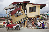 Philippines. Province Eastern Samar. Hernani. House blown and destroyed by typhoon Haiyan's winds and storm surge. Sea of the Philippines. Pacific ocean. Typhoon Haiyan, known as Typhoon Yolanda in the Philippines, was an exceptionally powerful tropical cyclone that devastated the Philippines. Haiyan is also the strongest storm recorded at landfall in terms of wind speed. Typhoon Haiyan's casualties and destructions occured during a powerful storm surge, an offshore rise of water associated with a low pressure weather system. Storm surges are caused primarily by high winds pushing on the ocean's surface. The wind causes the water to pile up higher than the ordinary sea level. 26.11.13 © 2013 Didier Ruef