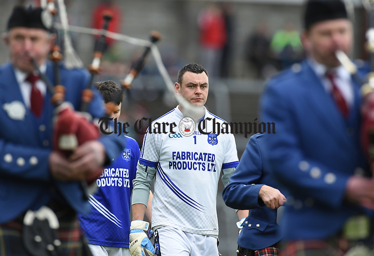 Cratloe captain Pierce DeLoughrey leads out his team behind the band before their senior football final replay againstKilmurry Ibrickane at Cusack park. Photograph by John Kelly.
