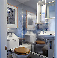 The cloakroom is decorated in a reflective silver paper; a drawing of a brooding Elvis Presley hangs on one wall.