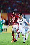 Guangzhou Midfielder Paulinho Maciel (L) fights for the ball with Kashima Midfielder Ogasawara Mitsuo (R) during the AFC Champions League 2017 Round of 16 match between Guangzhou Evergrande FC (CHN) vs Kashima Antlers (JPN) at the Tianhe Stadium on 23 May 2017 in Guangzhou, China. (Photo by Power Sport Images/Getty Images)