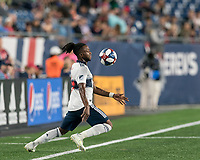 FOXBOROUGH, MA - JULY 18: Lass Bangoura #19 controls the ball during a game between Vancouver Whitecaps and New England Revolution at Gillette Stadium on July 18, 2019 in Foxborough, Massachusetts.