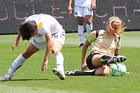 Leslie Osborne #10 of FC Gold Pride battles Aya Miyama #8 the Los Angeles Sol for control of a loose ball during their match at Home Depot Center on April 19, 2009 in Carson, California.