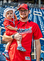 22 September 2018: A Washington Nationals Fan brings his young child to a ballgame against the New York Mets at Nationals Park in Washington, DC. The Nationals shut out the Mets 6-0 in the 3rd game of their 4-game series. Mandatory Credit: Ed Wolfstein Photo *** RAW (NEF) Image File Available ***