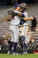 Fort Myers Miracle relief pitcher Luke Bard (24) and catcher Brian Navarreto (23) celebrate the final out during a game against the Bradenton Marauders on April 9, 2016 at McKechnie Field in Bradenton, Florida.  Fort Myers defeated Bradenton 5-1.  (Mike Janes/Four Seam Images)