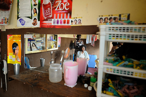 A beautician and her client in a shop in Likoni, Kenya.