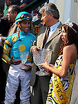 """15 May 09:  Jockey Garret Gomez, trainer Steve Asmussen and """"Miss Preakness"""" in the winner's circle after Heart Ashley win The Miss Preakness Stakes at Pimlico Race Course in Baltimore, Maryland on Black-Eyed Susan Day."""