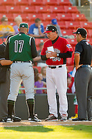Hickory Crawdads manager Bill Richardson #24 exchanges lineup cards at home plate with Augusta GreenJackets manager Lipso Nava #17 at L.P. Frans Stadium on April 29, 2011 in Hickory, North Carolina.   Photo by Brian Westerholt / Four Seam Images