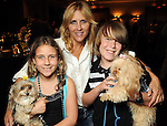 """From left: Kaia Mantor with Sake, Michelle Mantor and Stian Mantor with Friday at the """"Dog Days of Summer"""" Yappy Hour benefitting Citizens for Animal Protection and Golden Beginnings Golden Retriever Rescue at Hotel Derek Wednesday July 21,2010.(Dave Rossman/For the Chronicle)"""