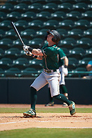 Patrick Dorrian (15) of the Greensboro Grasshoppers follows through on his swing against the Hickory Crawdads at L.P. Frans Stadium on May 26, 2019 in Hickory, North Carolina. The Crawdads defeated the Grasshoppers 10-8. (Brian Westerholt/Four Seam Images)