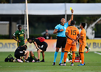 LAKE BUENA VISTA, FL - JULY 18: The referee Ismail Elfath shows a yellow card to Maynor Figueroa #15 of the Houston Dynamo during a game between Houston Dynamo and Portland Timbers at ESPN Wide World of Sports on July 18, 2020 in Lake Buena Vista, Florida.