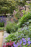 Mixed border garden with layered plants of differing heights