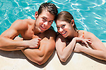 USA, California, Fairfax, Portrait of young couple in swimming pool