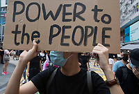 An anti-Extradition Bill protestor holds up a sign during a protest in Tsim Sha Tsui, Kowloon, Hong Kong, China, 04 August 2019.