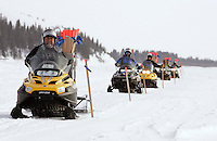 The Iditarod trail breakers mark the trail leaving the White Mountain checkpoint on tuesday afternoon shortly before Lance Mackey left for Nome.
