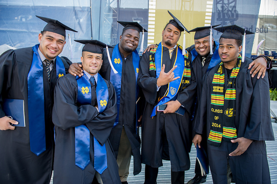 May 18, 2014; Former Notre Dame football players pose for a photo following the 2014 Commencement ceremony in Notre Dame Stadium. Photo by Matt Cashore/University of Notre Dame