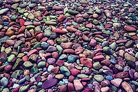 Colorful rocks on shore of Lake McDonald, Glacier National Park, Montana