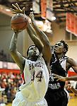 Lee's Gerron Scissum (23) blocks shot by Bob Jones' Reggie Ragland (34).  Bob Jones vs. Lee boy's basketball at Bob Jones High School Saturday Jan. 21, 2012. Lee won 55 to 54.  (The Huntsville Times / Bob Gathany)