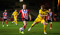 Lincoln City's Harry Anderson vies for possession with Milton Keynes Dons' Dean Lewington<br /> <br /> Photographer Chris Vaughan/CameraSport<br /> <br /> The EFL Sky Bet League One - Lincoln City v Milton Keynes Dons - Tuesday 11th February 2020 - LNER Stadium - Lincoln<br /> <br /> World Copyright © 2020 CameraSport. All rights reserved. 43 Linden Ave. Countesthorpe. Leicester. England. LE8 5PG - Tel: +44 (0) 116 277 4147 - admin@camerasport.com - www.camerasport.com