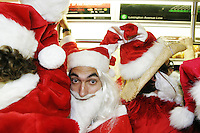 Hundreds of people dressed as Santa Claus cram into the subway in New York City on December 11, 2004 during Santacon, an annual ritual in which a large amount of people dress as St. Nick and wander around NYC en masse to the delight and chagrin of many.